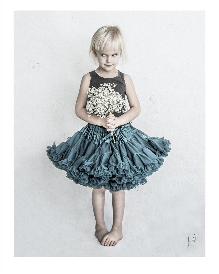 Blomsterflicka Foto